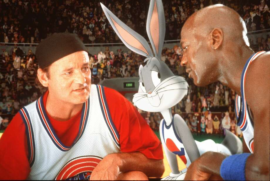 """Bill Murray, left, Bugs Bunny, and Michael Jordan are shown in a scene from the Warner Bros. film """"Space Jam,"""" in this handout photo. The film, with a $48.5 million two-week box office take, marked the first time a rival has made a serious dent in Disney's virtual monopoly of the feature animation market. (AP Photo/HO, Warner Bros.) Photo: Associated Press"""
