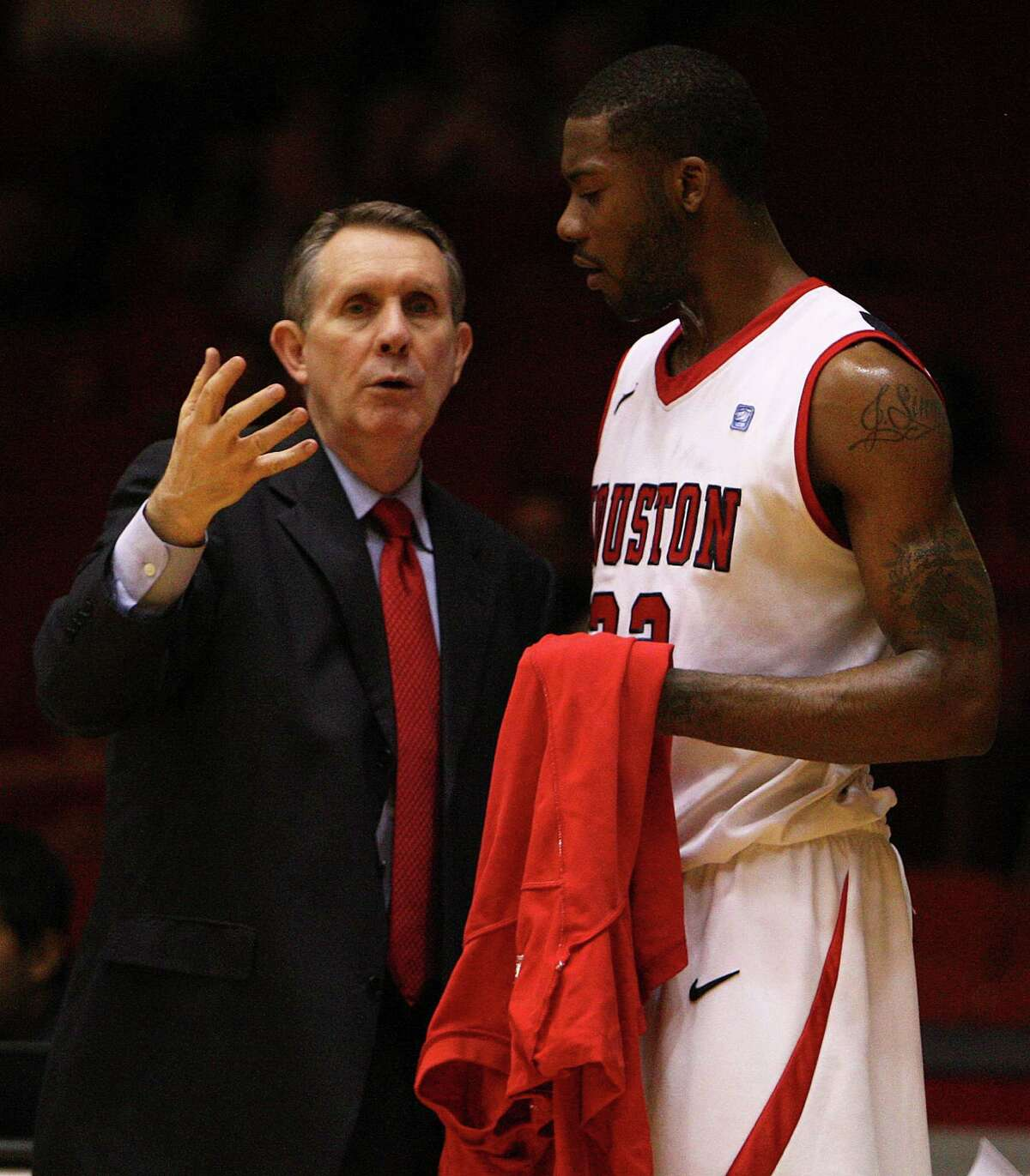 Houston head coach James Dickey speaks with Jonathon Simmons on the sidelines during the game against Tulane Hofheinz Pavilion on Feb. 29, 2012.
