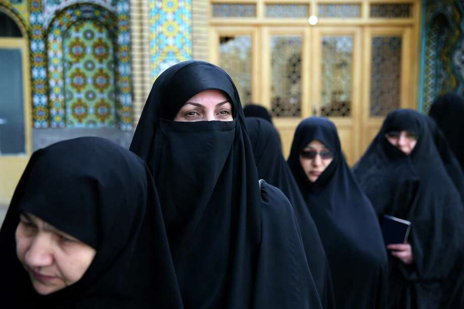 Iranian women line up to vote Friday in Qom,  78 miles south of Tehran. The election was the first since the landmark nuclear deal with world powers.   Photo: Ebrahim Noroozi, STR / ap