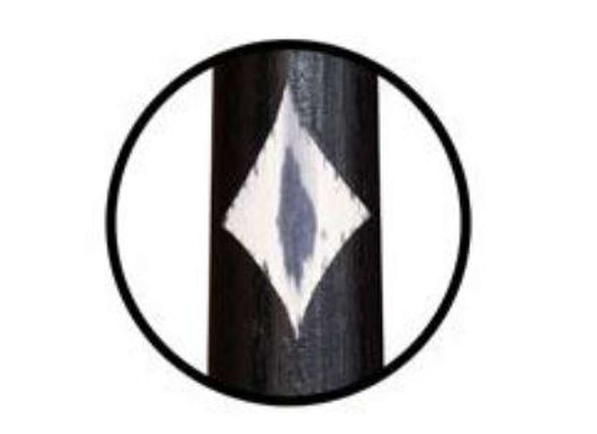 A diamond shaped ink mark on one of Cooperstown Bat Co.'s bats.