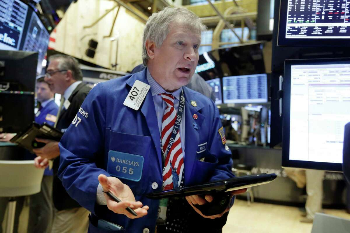 Trader Richard Newman works on the floor of the New York Stock Exchange, Friday, Feb. 26, 2016. U.S. stocks opened higher and remained on track for a second straight weekly gain on encouraging economic news in the U.S. and word from China that the country won't devalue its currency to make its exports more competitive. (AP Photo/Richard Drew) ORG XMIT: NYRD108