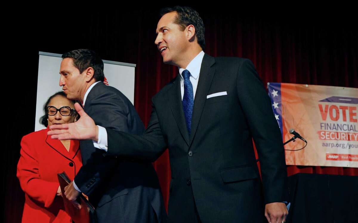 After the debate between incumbent Jose Menendez,R and challenger Trey Martinez Fischer, candidates for Texas Senate District 26 took time to congratulate the moderator,not in frame and AARP, Excutive councilwoman Julia Castellano-Hoyt on Friday, January 29, 2016 at the Guadalupe Cultural Arts Center.
