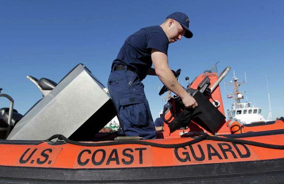 Harrison Dunn of the Coast Guard cleans a 17-foot patrol boat as part of the drill to respond to a Category 3 hurricane. Photo: J. Patric Schneider, Freelance / © 2016 Houston Chronicle