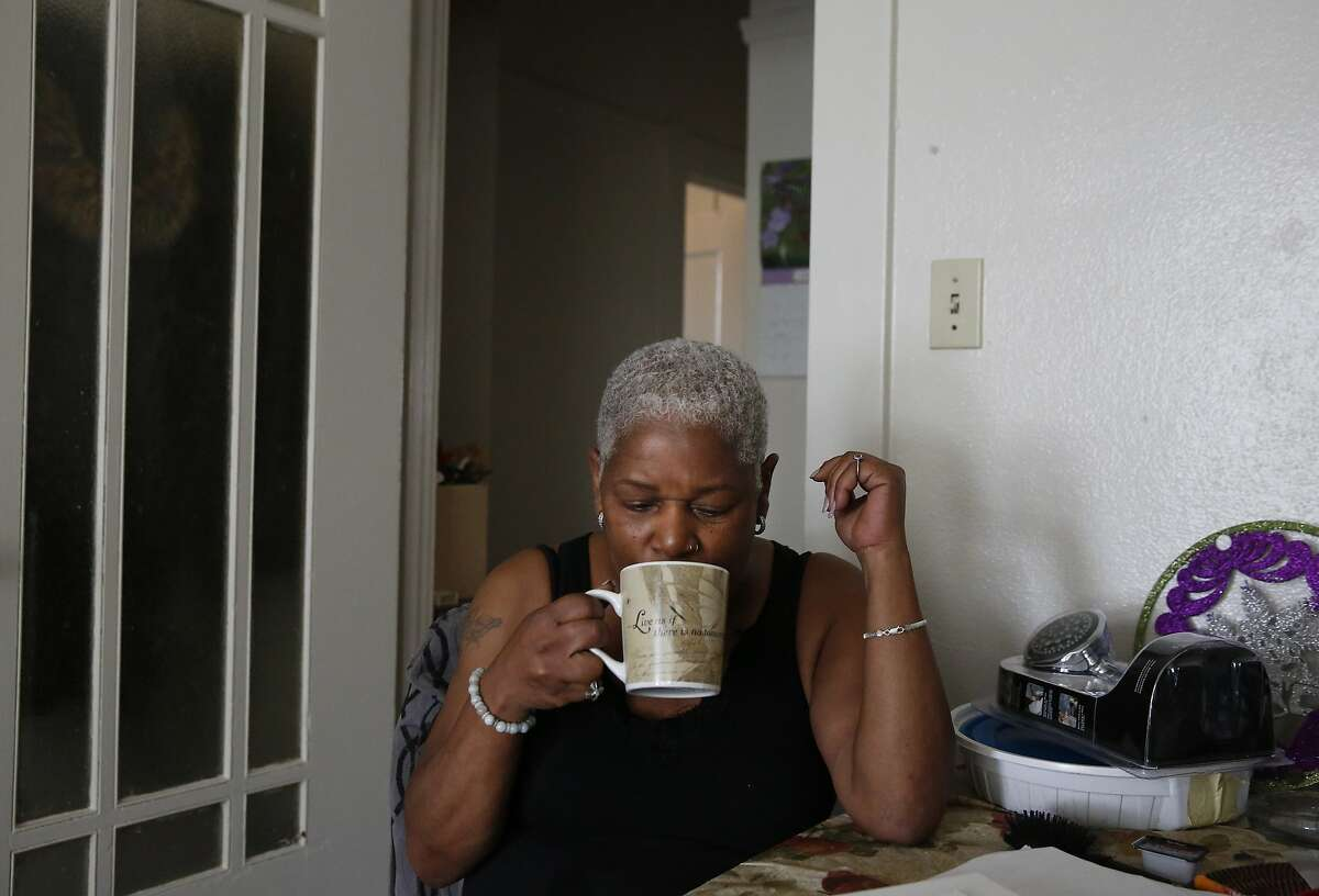 Miss Vicky Blake has her morning coffee at her apartment Feb. 26, 2016 in San Francisco, Calif. Miss Vicky lives in housing for HIV positive women located in San Francisco. Miss Vicky will be celebrating her 12th year clean and sober and having lived with and survived over 20 years of being HIV positive.