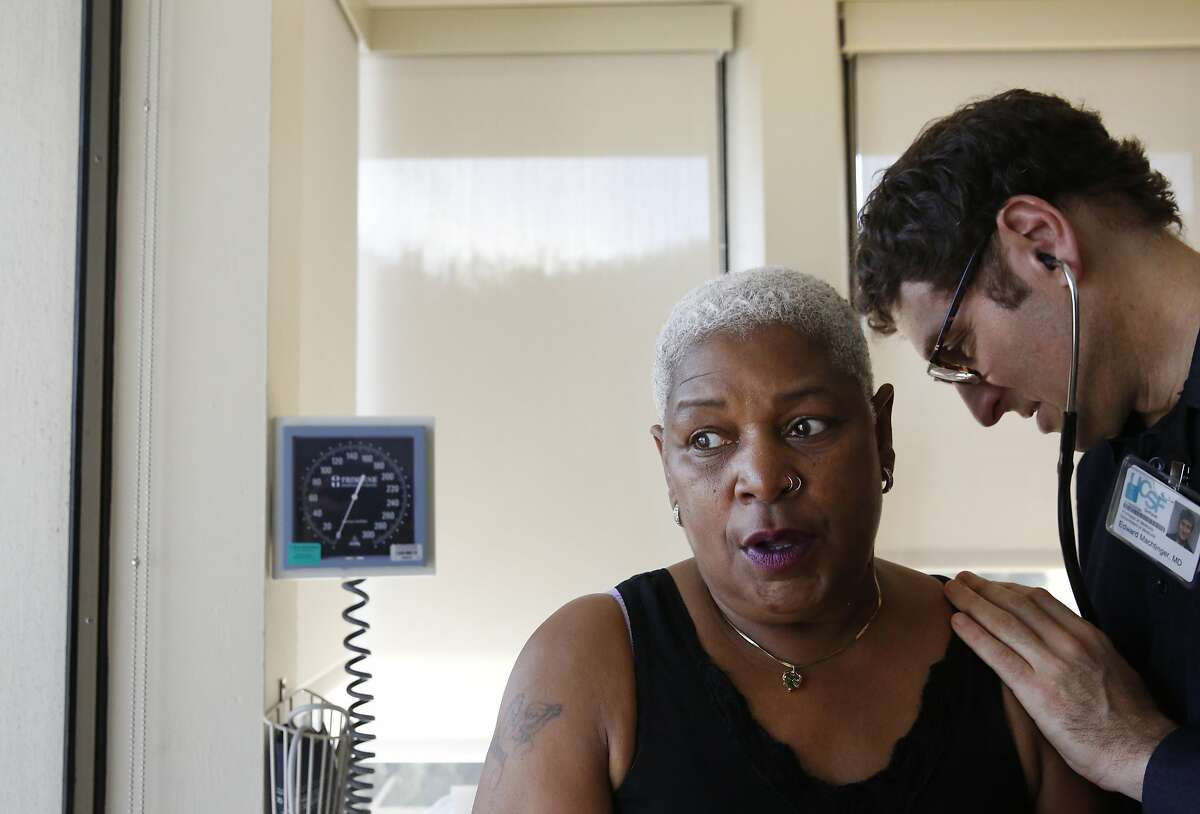 Dr. Edward Machtinger, right, examines Miss Vicky Blake during her check-up in the clinic at the Women's HIV Program at UCSF Jan. 27, 2016 in San Francisco, Calif. Miss Vicky has been seeing Dr. Machtinger for over 10 years, after an HIV positive diagnosis derailed her life in the early 90s.
