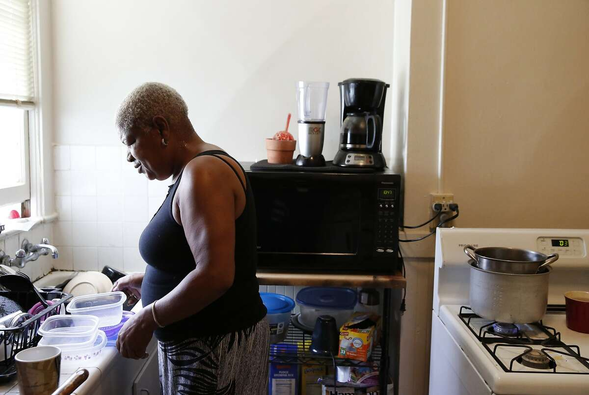 Miss Vicky Blake organizes tupperware containers in her kitchen at her apartment Feb. 26, 2016 in San Francisco, Calif. Miss Vicky lives in housing for HIV positive women located in San Francisco. Miss Vickie will be celebrating her 12th year clean and sober and having lived with and survived over 20 years of being HIV positive.