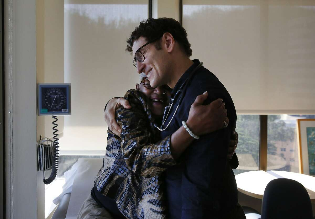 Miss Vicky Blake and Dr. Edward Machtinger hug as they greet each other hello during the beginning of her exam in the clinic at the Women's HIV Program at UCSF Jan. 27, 2016 in San Francisco, Calif. Miss Vicky has been seeing Dr. Machtinger for over 10 years, after an HIV positive diagnosis derailed her life in the early 90s.