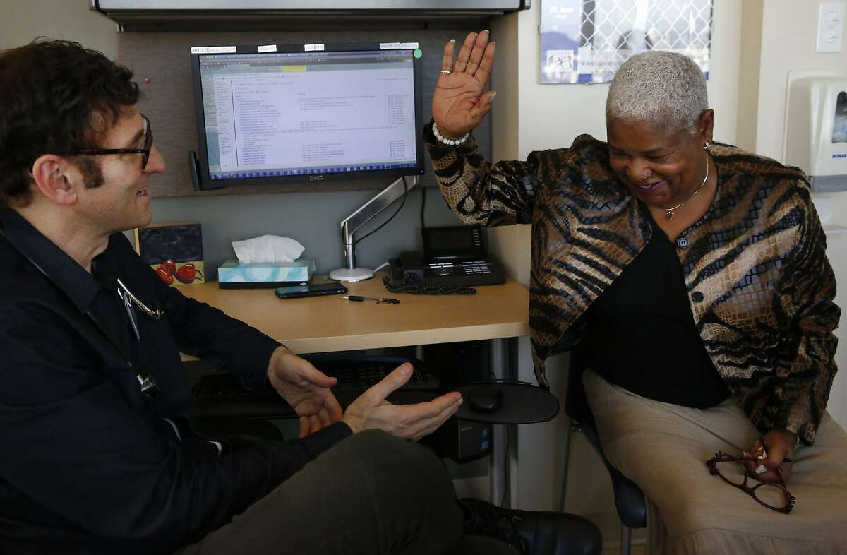 Dr. Edward Machtinger, left, jokes with Miss Vicky Blake during her exam in the clinic at the Women's HIV Program at UCSF Jan. 27, 2016 in San Francisco, Calif. Miss Vicky has been seeing Dr. Machtinger for over 10 years, after an HIV positive diagnosis derailed her life in the early 90s.