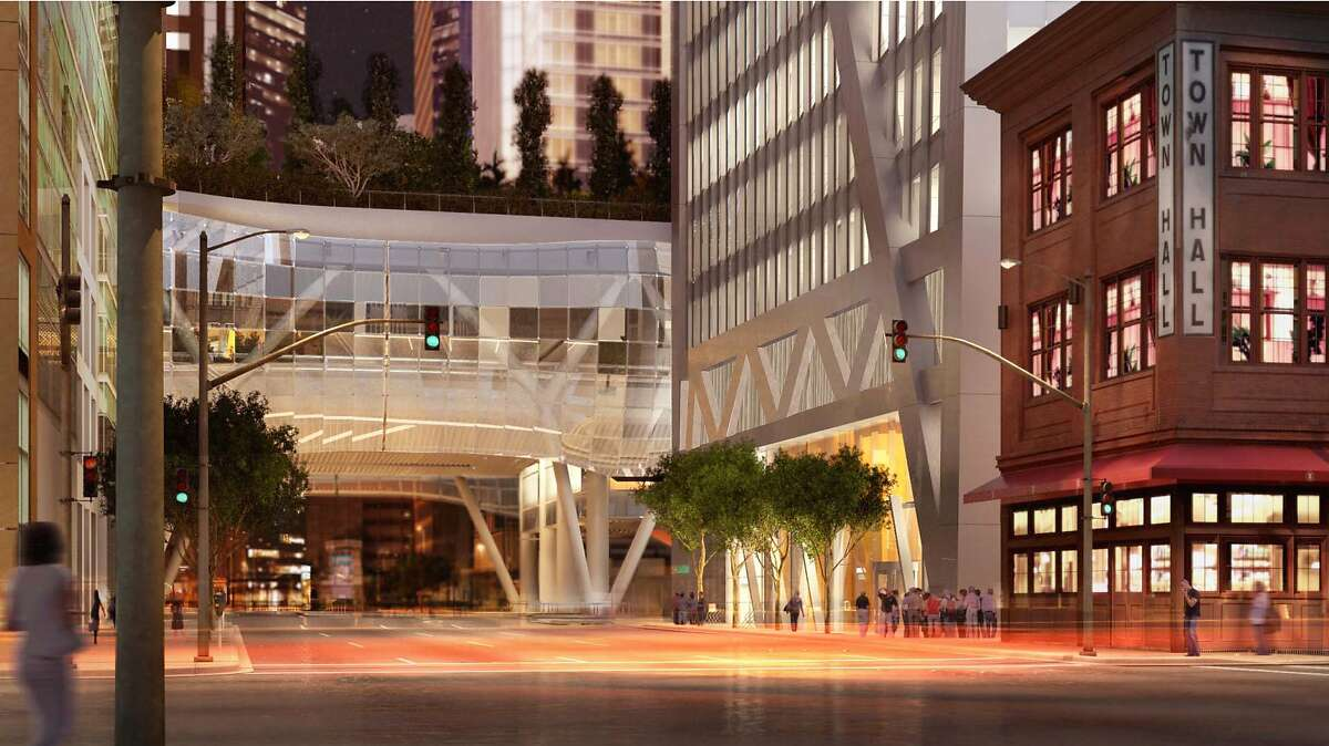 A rendering of the 181 Fremont tower designed by Heller Manus Architects shows a night view look at how the high-rise will appear alongside the existing 1907 brick structure at 342 Howard St. that houses Town Hall restaurant and a child care facility. The tower now is under construction, and includes an elaborate netting structure to prevent items falling from the rising structure onto 342 Howard's roof.