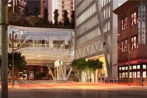 A rendering of the 181 Fremont tower designed by Heller Manus Architects, a night view showing how the high-rise will look alongside the existing 1907 brick structure at 342 Howard St. that houses Town Hall restaurant and a child care facility. The tower now is under construction, and incluces and elaborate netting structure to prevent items falling from the rising structure onto 342 Howard's roof.