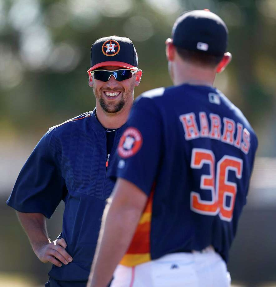 Astros pitchers Luke Gregerson, left, hasn't thrown off the mound, but Ken Giles, his competition for the closer's job, threw batting practice in Kissimmee, Fla., on Friday. Photo: Karen Warren, Staff / © 2015  Houston Chronicle