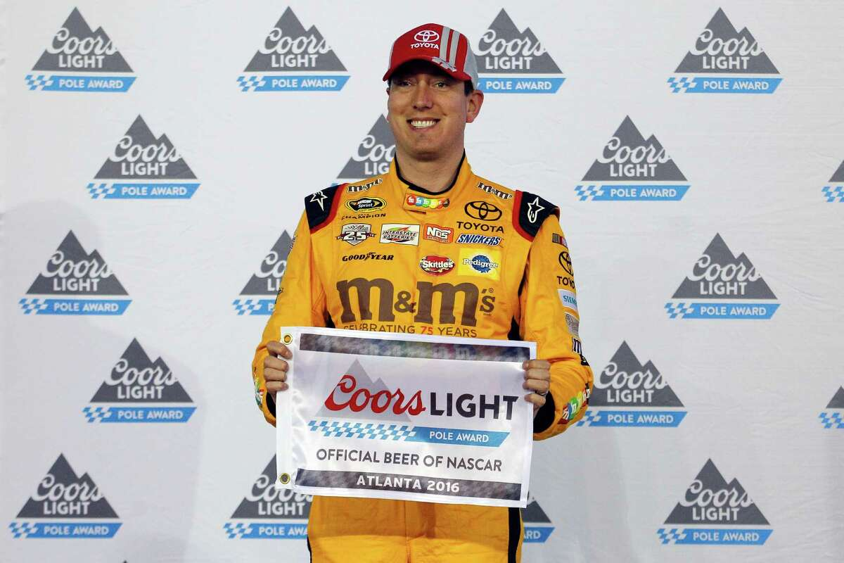 HAMPTON, GA - FEBRUARY 26: Kyle Busch, driver of the #18 M&M's 75 Toyota, poses with the Coors Light Pole Award after qualifying for pole position for the NASCAR Sprint Cup Series Folds of Honor QuikTrip 500 at Atlanta Motor Speedway on February 26, 2016 in Hampton, Georgia. (Photo by Matt Hazlett/Getty Images) ORG XMIT: 595528363