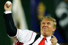Native New Yorker Donald Trump throws out the ceremonial first pitch before a Yankees game at Fenway Park in 2006.