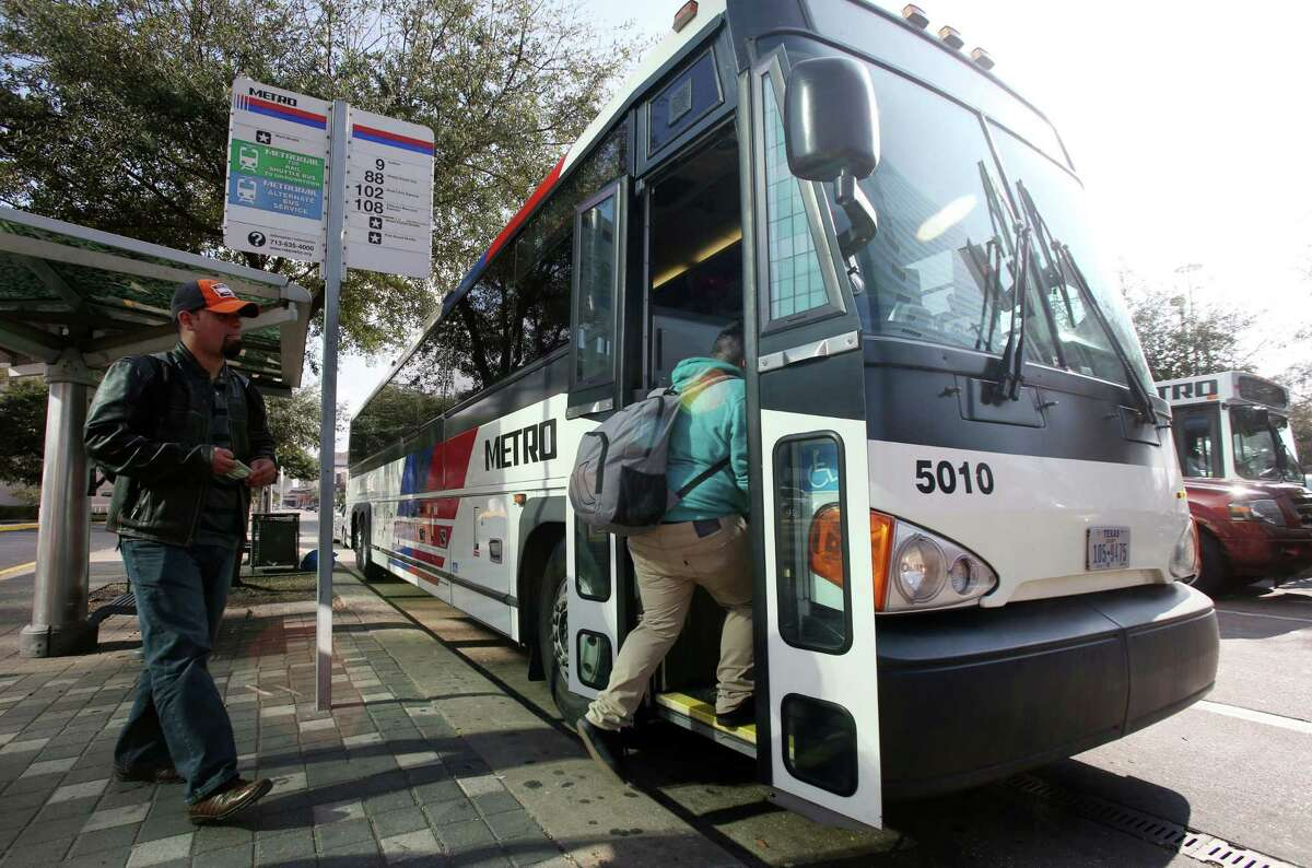 Riders board a Metro bus near the Downtown Transit Center in 2014. Bus rides are among the services that soon will be provided free to disabled veterans.