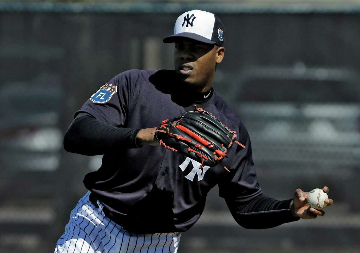 New York Yankees pitcher Aroldis Chapman throws a ball during a spring training baseball workout Friday, Feb. 19, 2016, in Tampa, Fla. (AP Photo/Chris O'Meara) ORG XMIT: FLCO118