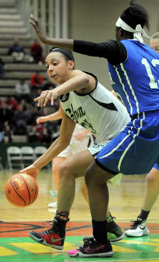 Shen's Sydney Brown, left, drives around Shaker's Ce Ce Mayo during their Class AA basketball semifinal on Friday, Feb. 26, 2016, at Hudson Valley Community College in Troy, N.Y. (Cindy Schultz / Times Union) Photo: Cindy Schultz / Albany Times Union