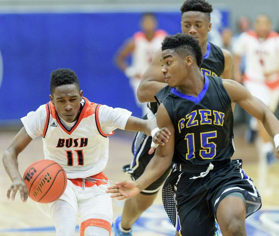 Calvin Tyler (15) of the Beaumont Ozen Panthers battles Remy Minor (11) of the Fort Bend Bush Broncos for the ball in the second half of a high school basketball game on Friday, February 26, 2016 at the Winnie Brown Gym at Sterling High School in Baytown Texas. Photo: Wilf Thorne, For The Chronicle / © 2016 Houston Chronicle