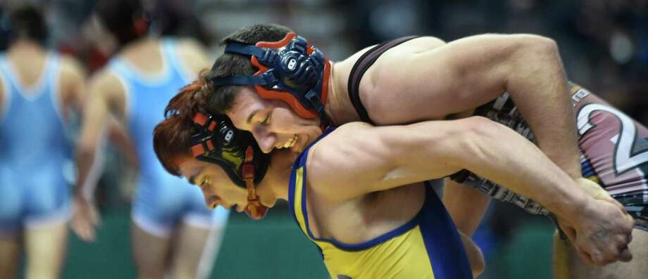 Schenectady's Collin Derboghossian, right, grapples with Fulton's Travis Race at 170 pounds in Division I during the state wrestling championships on Friday, Feb. 26, 2016, at Times Union Center in Albany, N.Y. Derboghossian wins 7-2. (Cindy Schultz / Times Union) Photo: Cindy Schultz / Albany Times Union