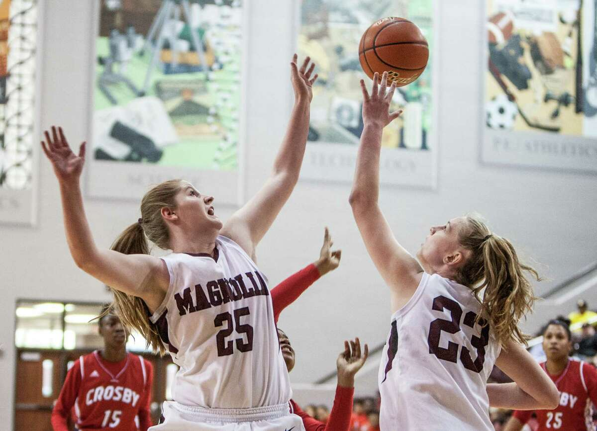 Peighton Highsmith and Alexus Wykoff of Magnolia reach for a rebound during a game Friday February 26, 2016. Magnolia played Crosby in the girls basketball Region III semifinals at the Campbell Center.