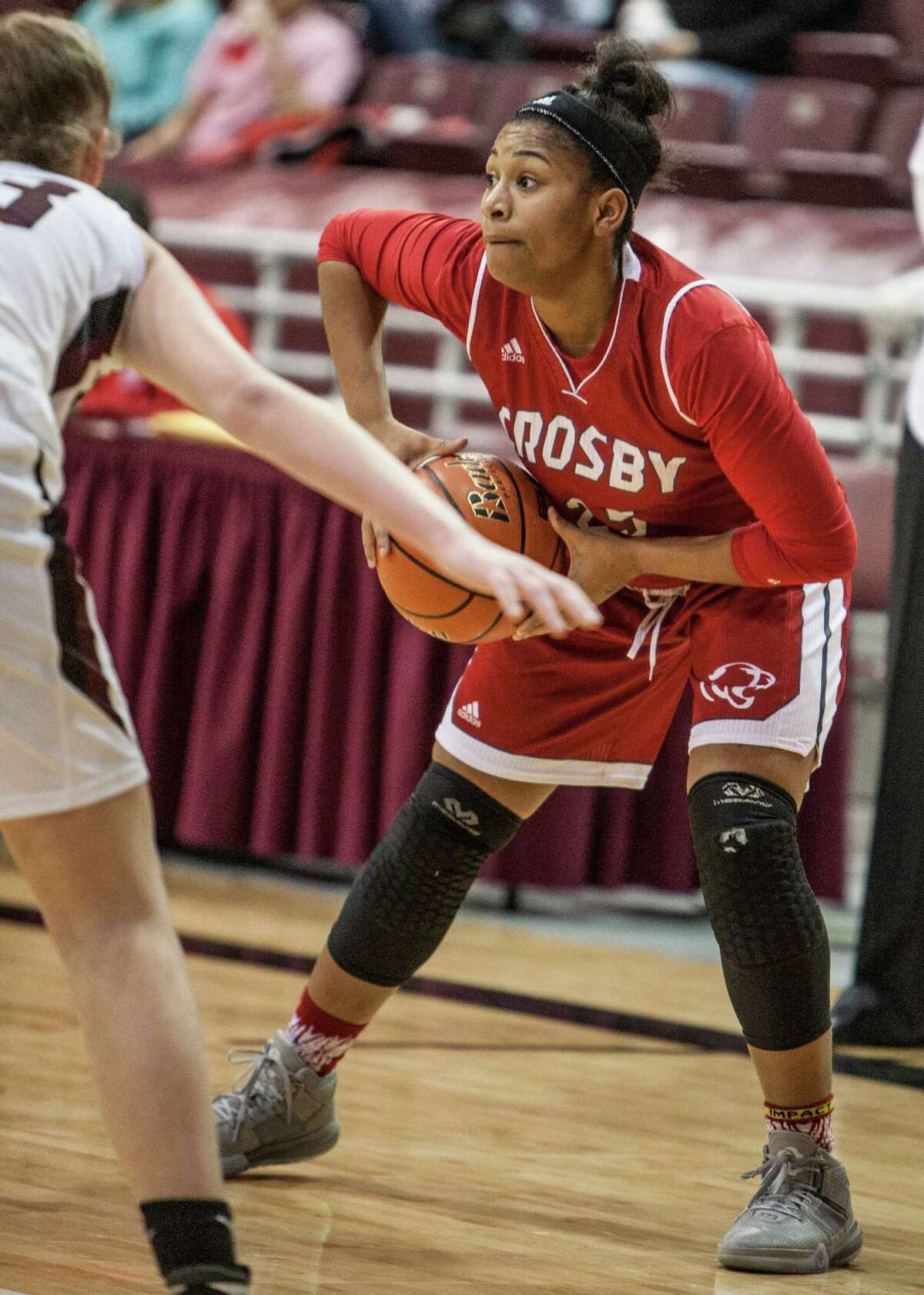 Amaya Armstrong of Crosby looks to pass during a game Friday February 26, 2016. Magnolia played Crosby in the girls basketball Region III semifinals at the Campbell Center.