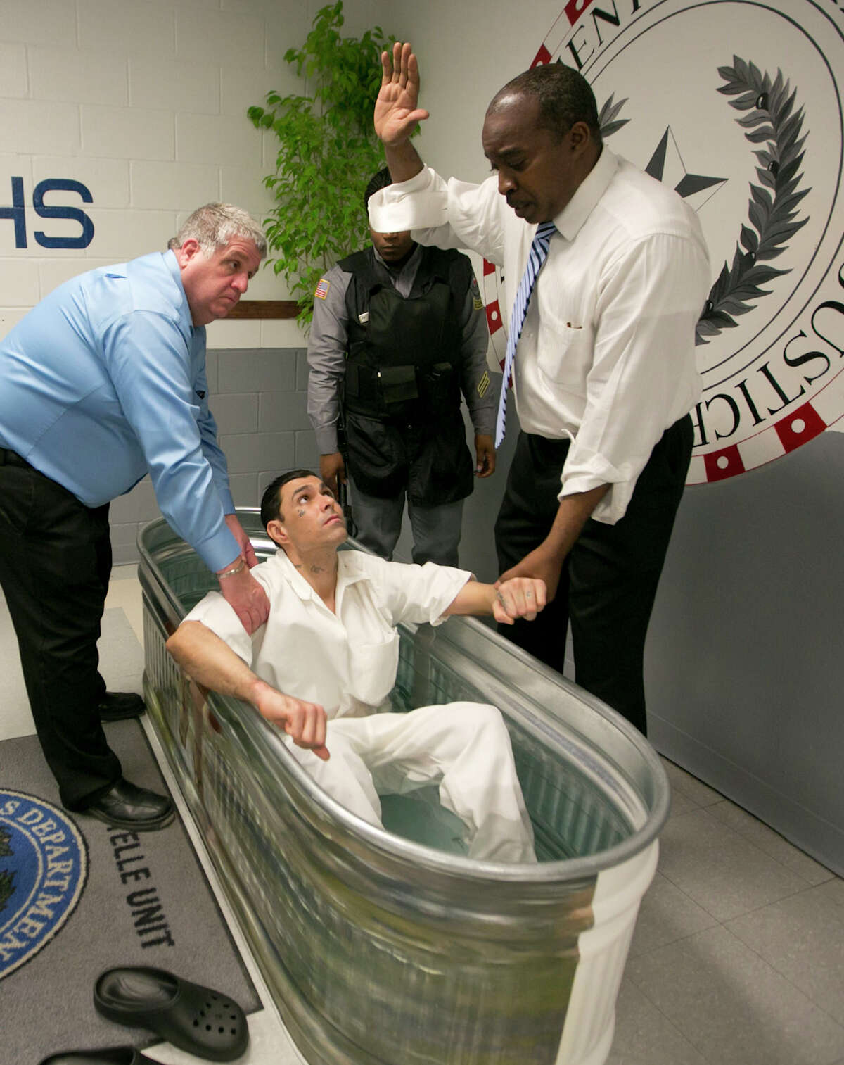 One of three prison inmates is baptized Friday at the Texas Department of Criminal Justice's Estelle High-Security Unit in Huntsville.