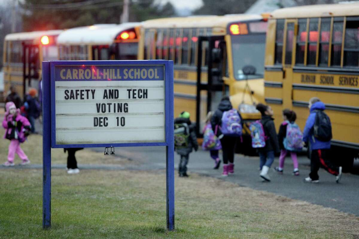Students at the Carroll Hill Elementary School arrive for class on Dec. 10, 2013, in Troy, N.Y. (Skip Dickstein / Times Union archive)