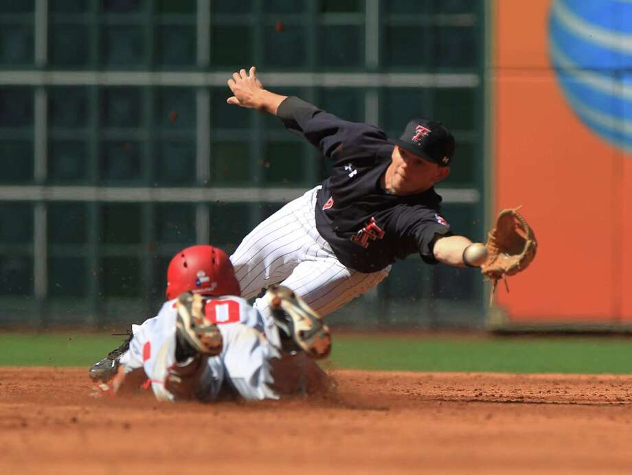 Texas Tech second baseman Michael Davis, top, misses a throw as Houston's Connor Wong steals second base during the third inning of Friday's game at Minute Maid Park. Texas Tech won 3-2. Photo: Jon Shapley, Staff / © 2015  Houston Chronicle