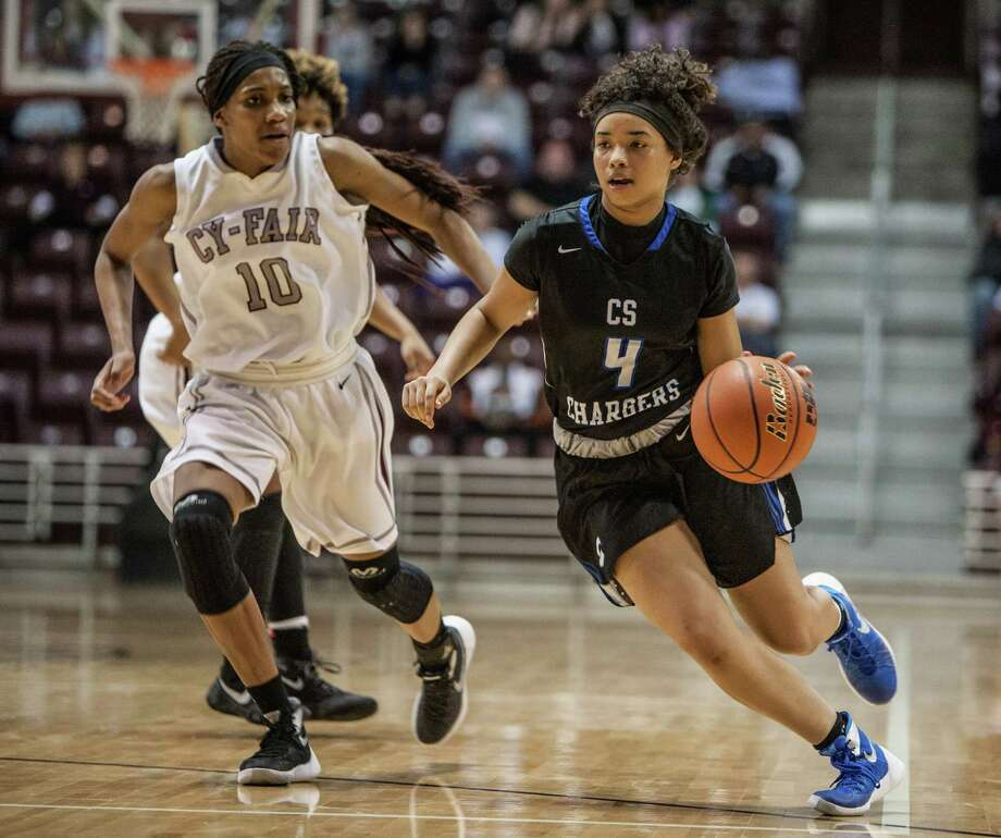 Clear Springs' Dymond Gladney, right, proves too elusive for Cy-Fair. She had a team-high 20 points. Photo: Michael Starghill, Jr., Photographer / © 2016 Michael Starghill, Jr.