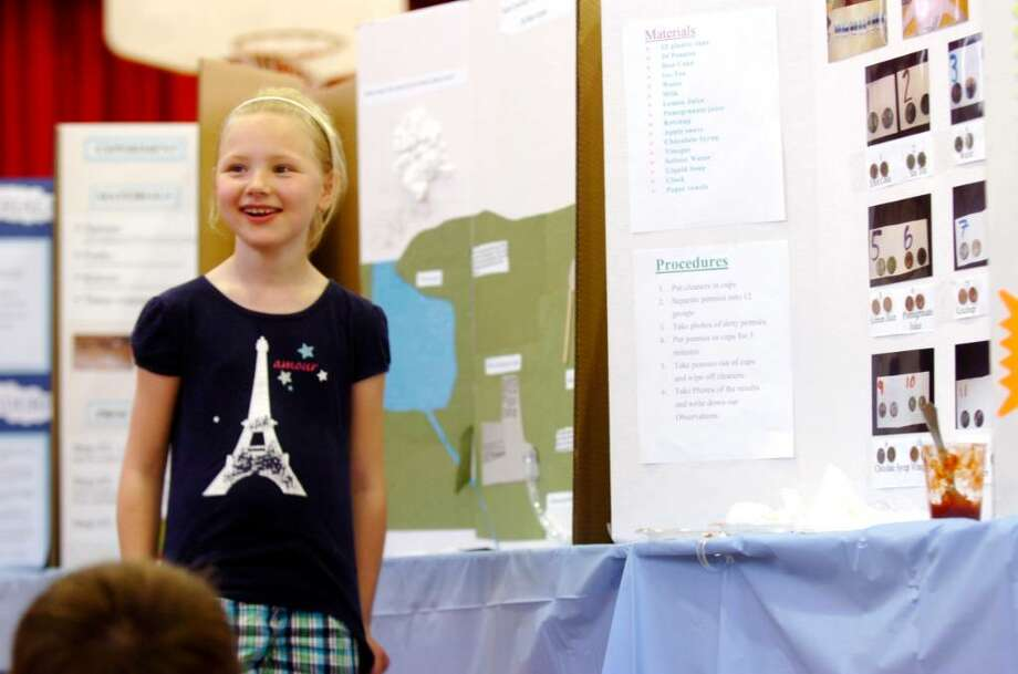 Second-grade student at Riverside School Sophie Dixie talks to her class about her science project, how to clean a penny, at the school's annual science fair, on Wednesday, April 7, 2010. Photo: Helen Neafsey / Greenwich Time