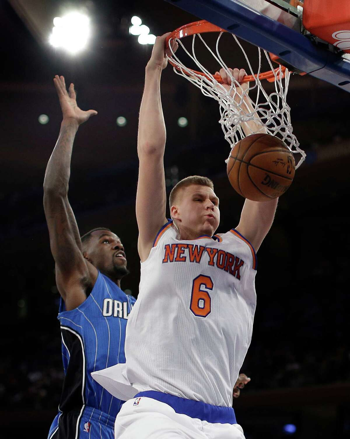 New York Knicks forward Kristaps Porzingis (6) dunks against Orlando Magic center Dewayne Dedmon (3) during the fourth quarter of an NBA basketball game, Friday, Feb. 26, 2016, in New York. The Knicks won 108-95.(AP Photo/Julie Jacobson) ORG XMIT: NYJJ108