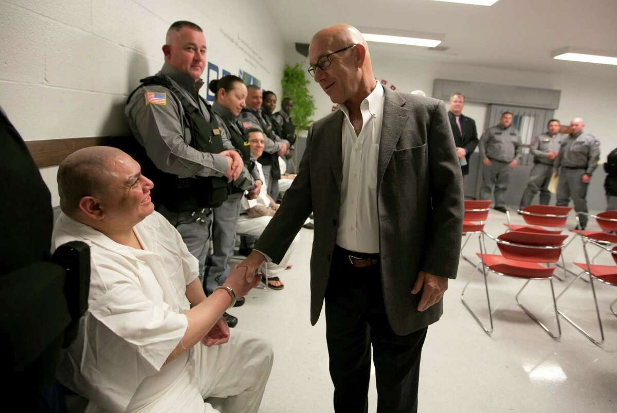Sen. John Whitmire, right, talks with prison inmate Davey Enrique before the baptism starts at the TDCJ Estelle Unit in Hunstville, Texas on February 26th, 2016.