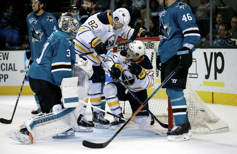 Buffalo Sabres left wing Johan Larsson (22) celebrates with teammate Marcus Foligno (82) after scoring a goal past San Jose Sharks goalie Martin Jones, left, during the second period of an NHL hockey game Friday, Feb. 26, 2016, in San Jose, Calif. Photo: Tony Avelar, AP / FR155217 AP