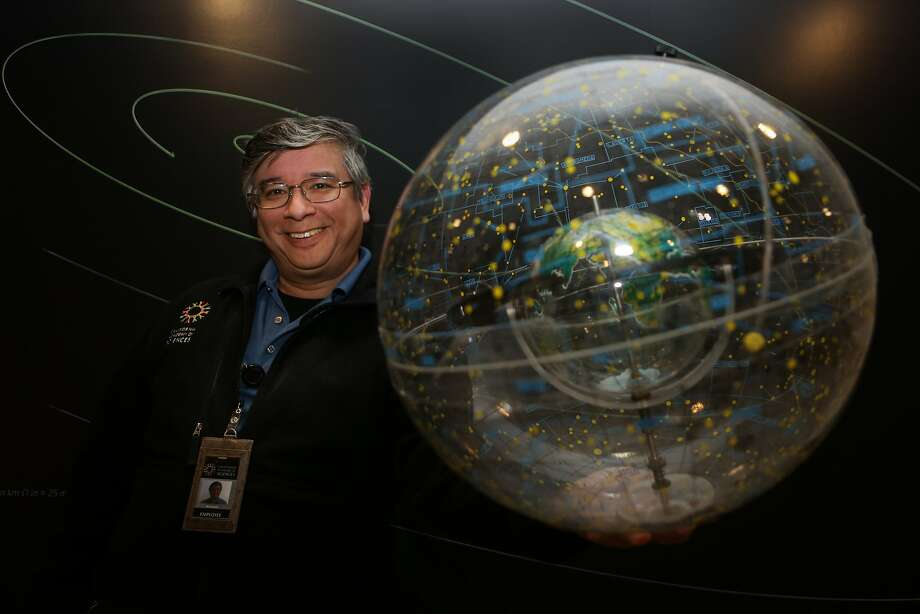Astronomer Bing Quock of the Morrison Planetarium holds a constellation globe at the Academy of Sciences on Friday, Feb. 26, 2015 in San Francisco, Calif. Photo: Amy Osborne, Special To The Chronicle