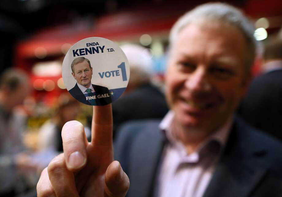 A Fine Gael supporter holds a badge showing Prime Minister Enda Kenny during ballot counting in Castlebar, Ireland. Photo: Paul Faith, AFP / Getty Images