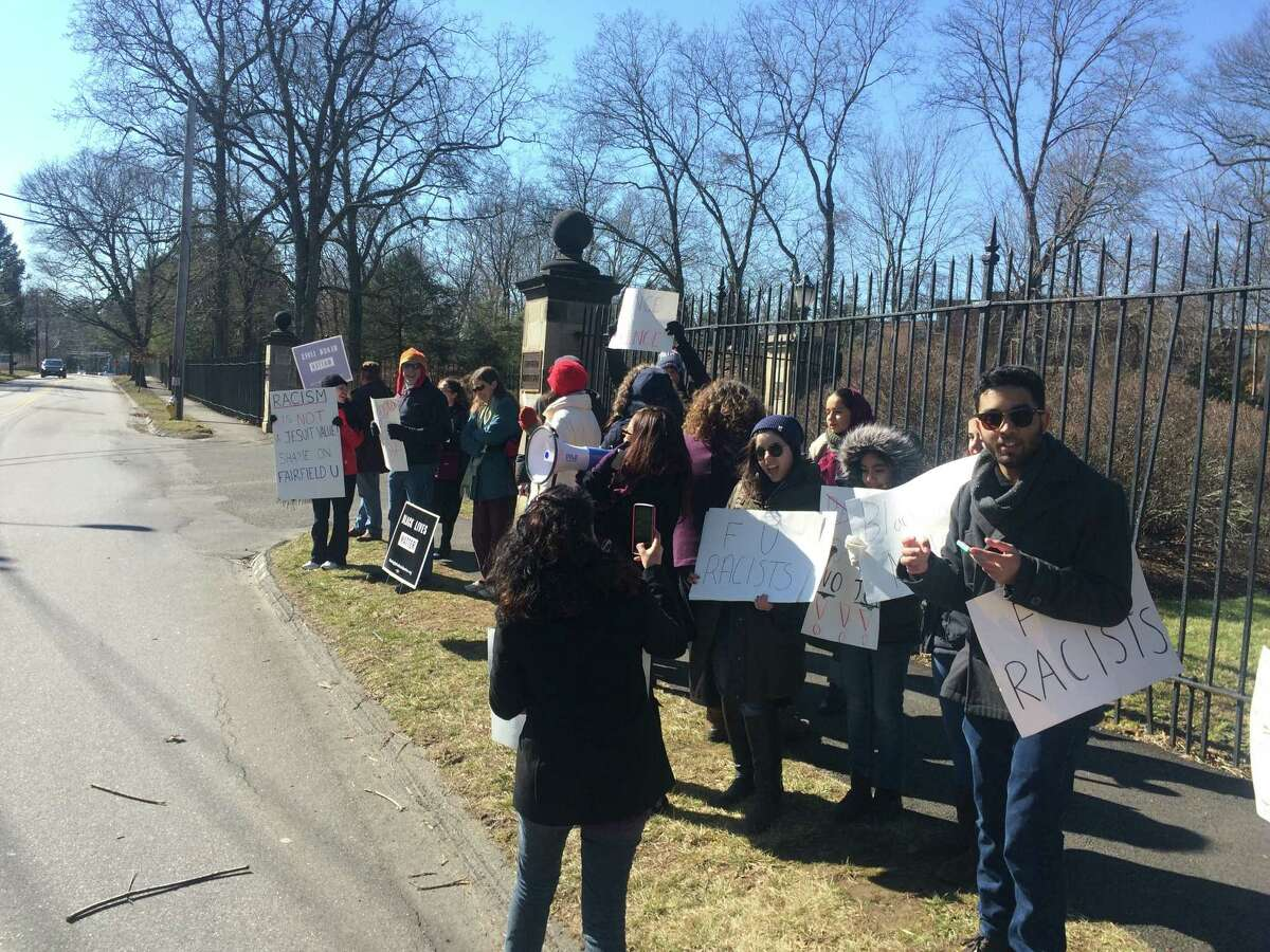 Fairfield University alumni and other Connecticut residents protested on Saturday against an earlier