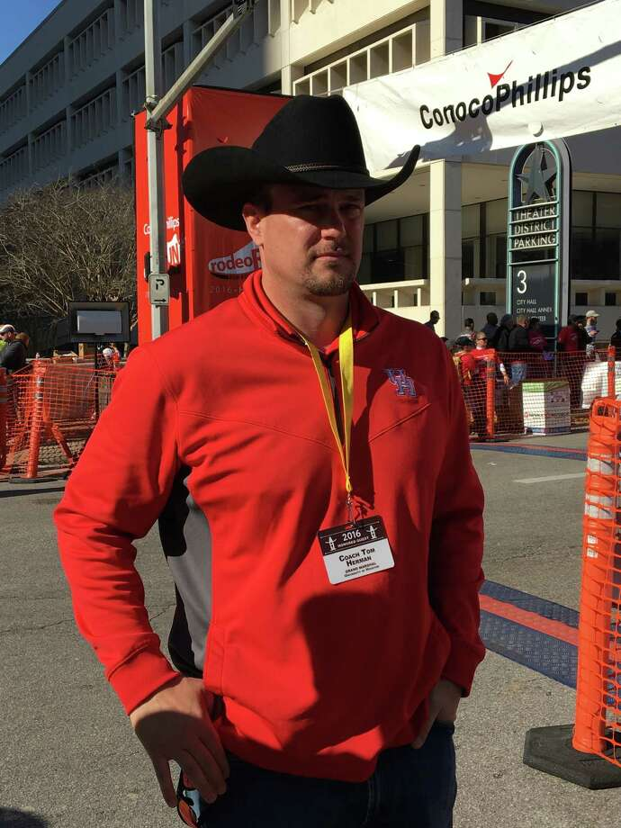 UH coach Tom Herman serves as the Grand Marshal at the Houston Livestock Show & Rodeo downtown parade. Photo: Joseph Duarte / Houston Chronicle