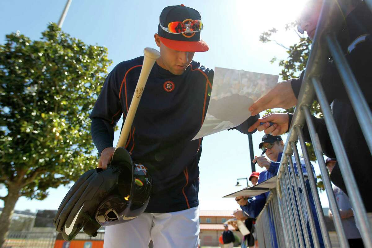 Houston Astros outfielder Jake Marisnick signs an autograph at the Astros spring training in Kissimmee, Florida, Saturday, Feb. 27, 2016.