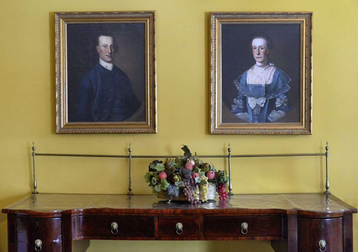 Portraits of Abraham, left, and Elizabeth Ten Broeck from the 1760s inside the Ten Broeck Mansion Tuesday Feb. 3, 2015, in Albany, NY. (John Carl D'Annibale / Times Union)