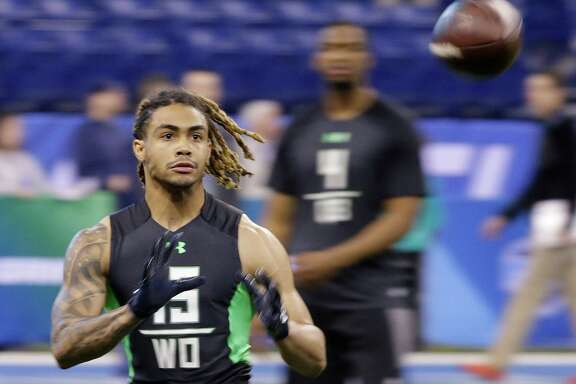 Notre Dame receiver Will Fuller runs a drill at the NFL football scouting combine in Saturday, Feb. 27, 2016, in Indianapolis. (AP Photo/Darron Cummings)