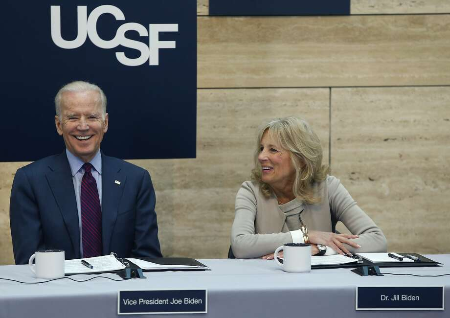 Vice President Joseph Biden and his wife Jill Biden smile while they participate in a panel discussion on cancer research at the UCSF Mission Bay campus in San Francisco, Calif. on Saturday, Feb. 27, 2016. Photo: Paul Chinn, The Chronicle