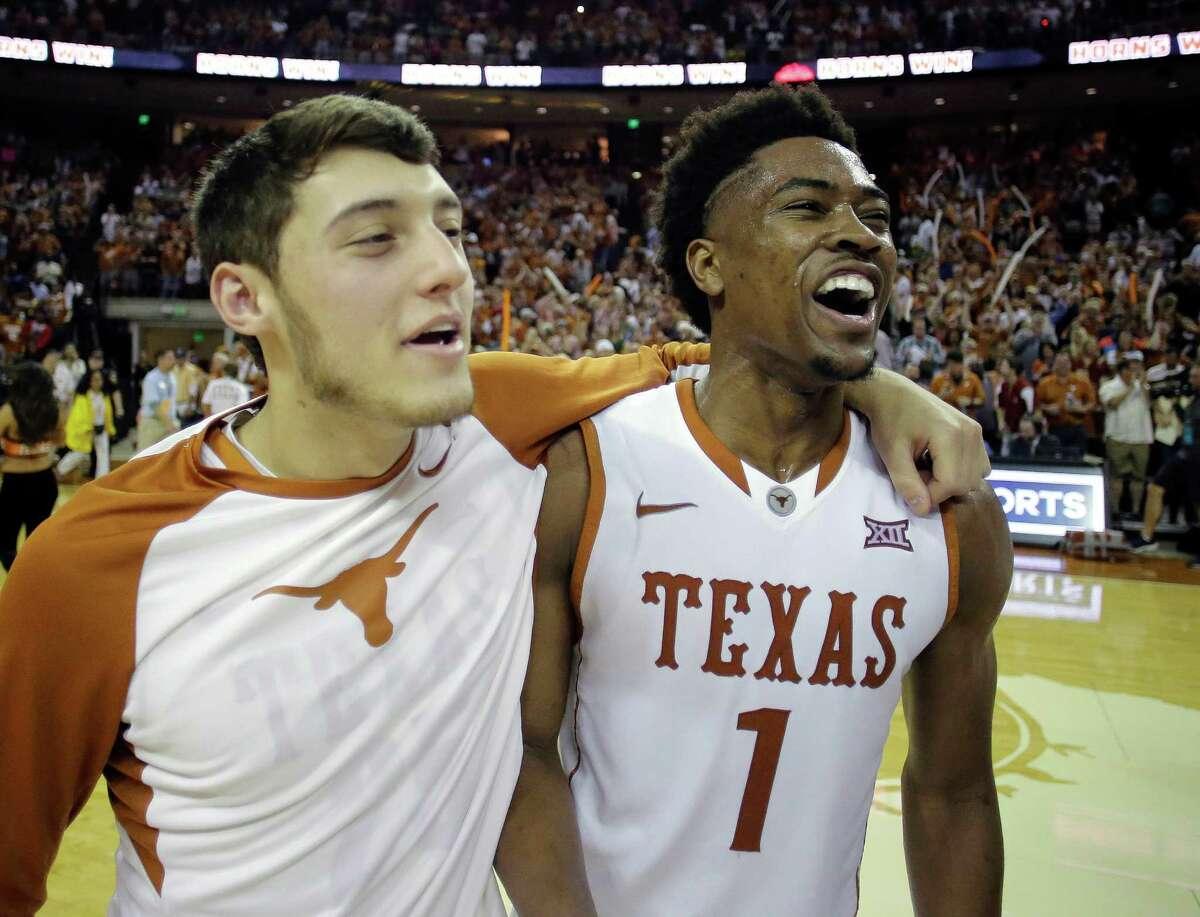 Texas guard Isaiah Taylor (1) celebrates with teammate Joe Schwartz, left, following an NCAA college basketball game against Oklahoma, Saturday, Feb. 27, 2016, in Austin, Texas. Texas won 76-63. (AP Photo/Eric Gay)
