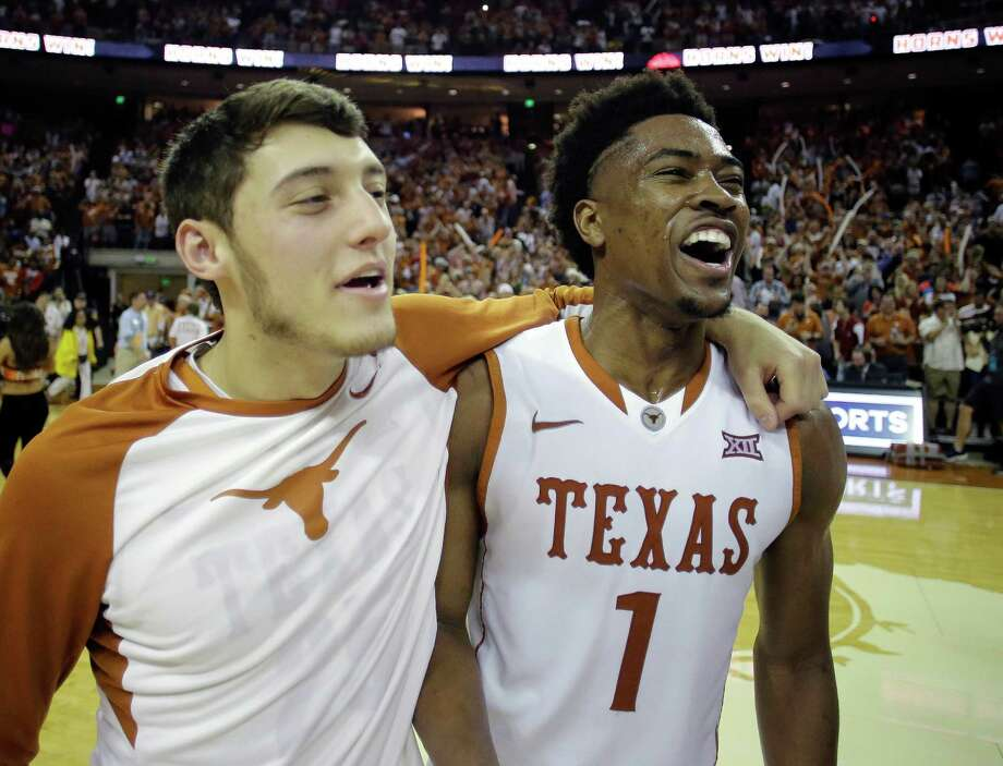 Texas guard Isaiah Taylor (1) celebrates with teammate Joe Schwartz, left,  following an NCAA college basketball game against Oklahoma, Saturday, Feb. 27, 2016, in Austin, Texas. Texas won 76-63. (AP Photo/Eric Gay) Photo: Eric Gay, Associated Press / AP