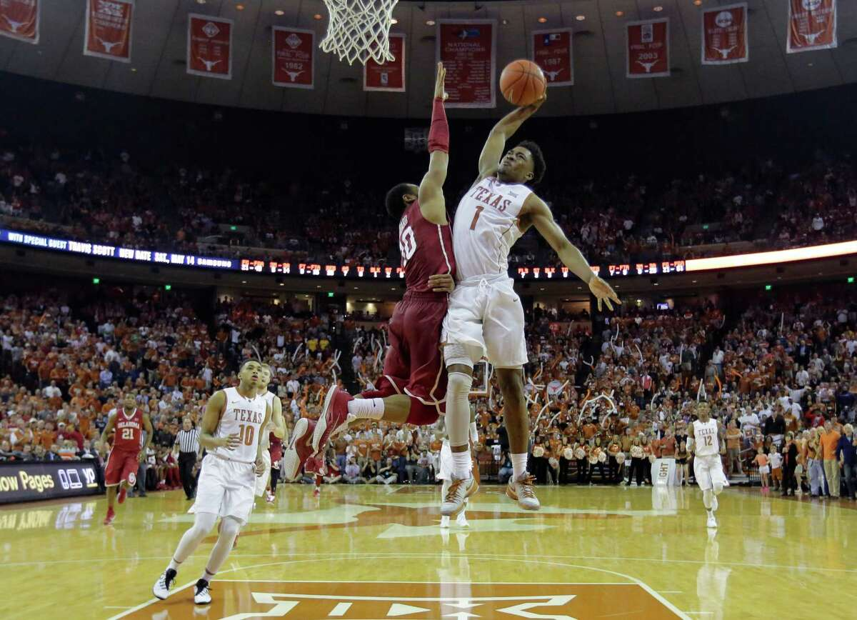 Texas guard Isaiah Taylor (1) drives to the basket against Oklahoma guard Jordan Woodard (10) during the second half of an NCAA college basketball game, Saturday, Feb. 27, 2016, in Austin, Texas. Texas won 76-63. (AP Photo/Eric Gay)