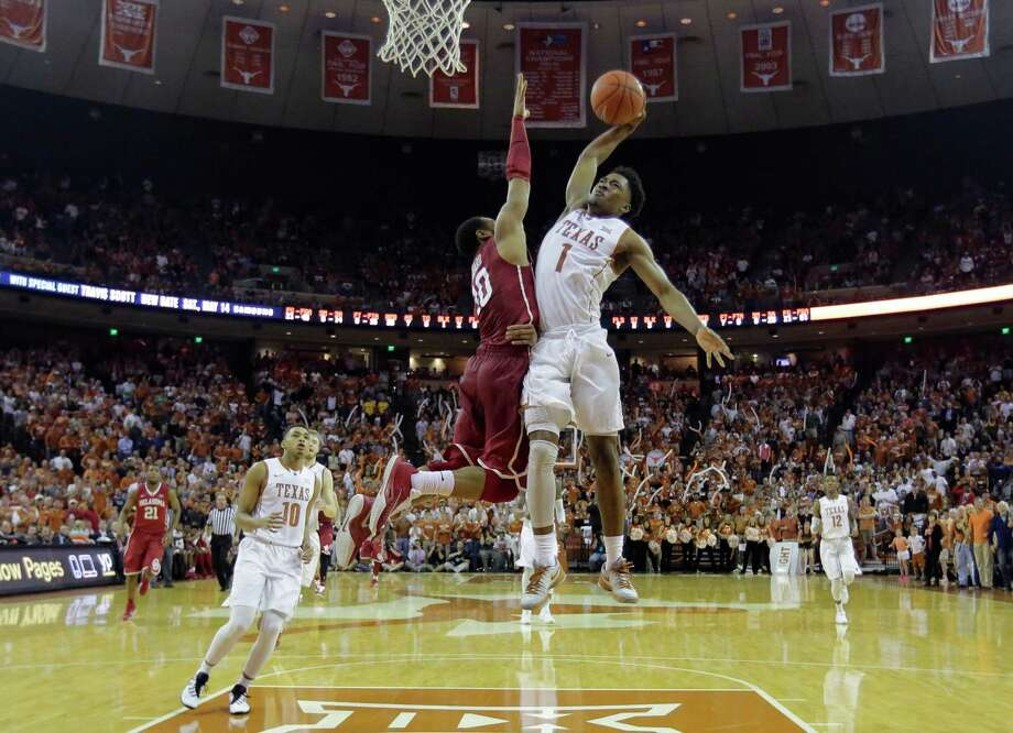 Texas guard Isaiah Taylor (1) drives to the basket against Oklahoma guard Jordan Woodard (10) during the second half of an NCAA college basketball game, Saturday, Feb. 27, 2016, in Austin, Texas. Texas won 76-63. (AP Photo/Eric Gay) Photo: Eric Gay, Associated Press / AP