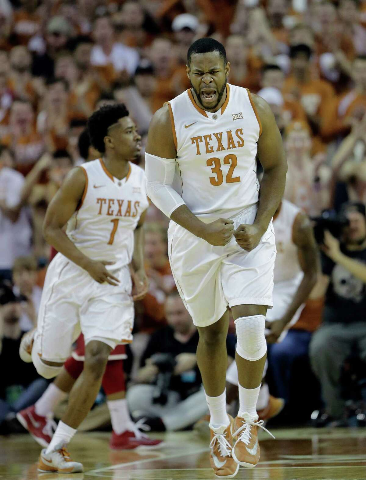 Texas forward Shaquille Cleare (32) celebrates a score against Oklahoma during the first half of an NCAA college basketball game, Saturday, Feb. 27, 2016, in Austin, Texas. (AP Photo/Eric Gay)