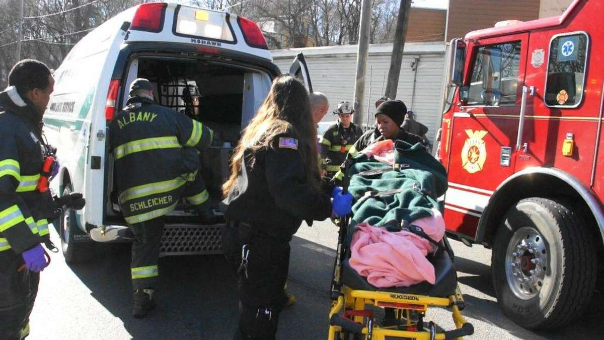An ambulance responds to the scene of a chase and crash that ended at a South Pearl Street building in Albany on Saturday afternoon, Feb. 27, 2016. (Martin Miller / Special to the Times Union)