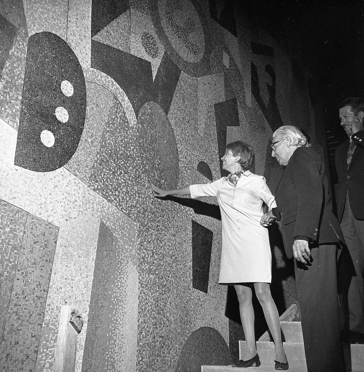 Mural artist Carlos Merida is shown in this Nov. 22, 1967, Express staff photo with Nancy Brown Negley, who commissioned it. Merida is seeing the mural installed in its final location for the first time. The man on the far right is unidentified. Credit: UTSA Libraries Special Collections/Express-News Collection