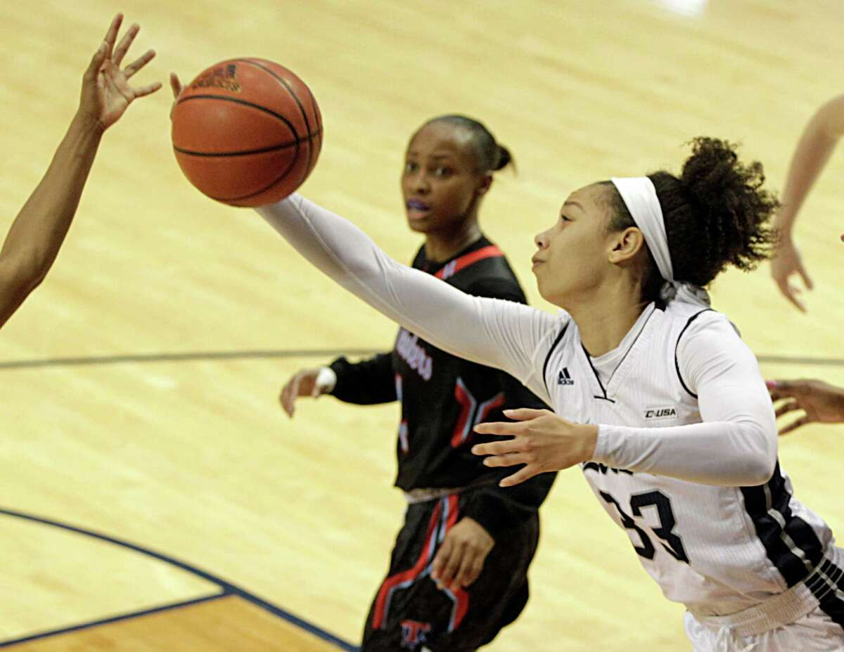 Rice Owls forward Jasmine Goodwine right, pulls in a rebound during the second quarter of women's college basketball game action against the Louisiana Tech Lady Techsters at Rice University's Tudor Fieldhouse Saturday, Feb. 27, 2016, in Houston.