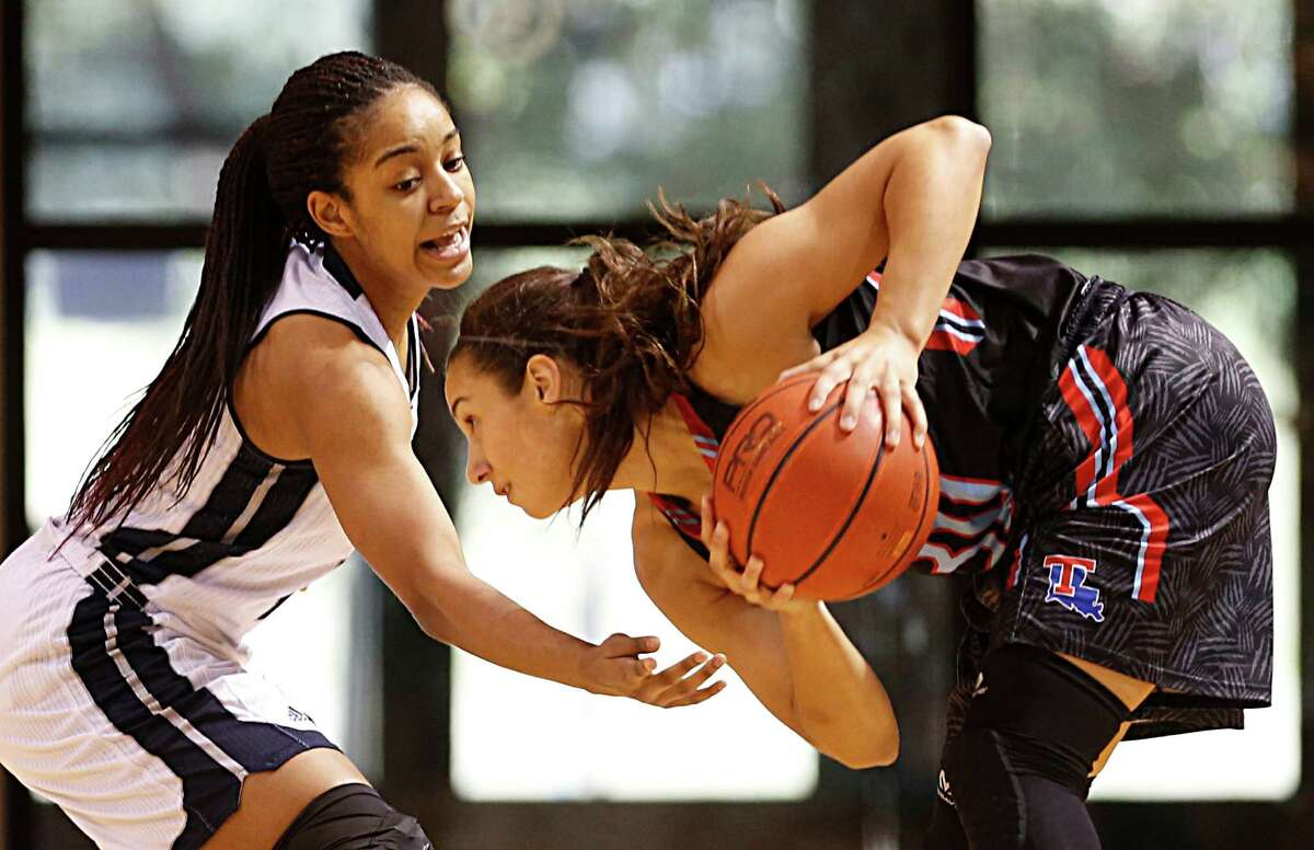 Rice Owls guard Shani Rainey left, and Louisiana Tech Lady Techsters guard Ashley Santos right, during the first quarter of women's college basketball game action at Rice University's Tudor Fieldhouse Saturday, Feb. 27, 2016, in Houston.