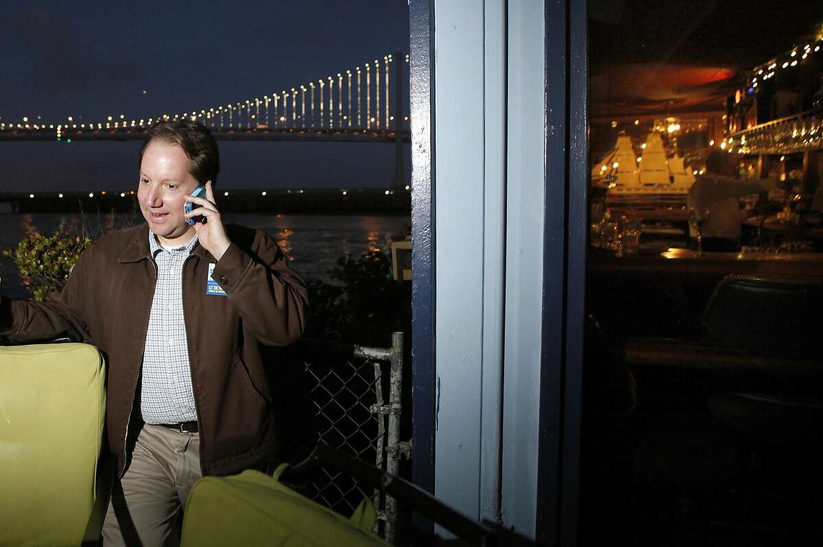 Jon Golinger takes a phone call at Sinbad's Restaurant on Pier 2 in San Francisco, CA, Tuesday June 3, 2014.